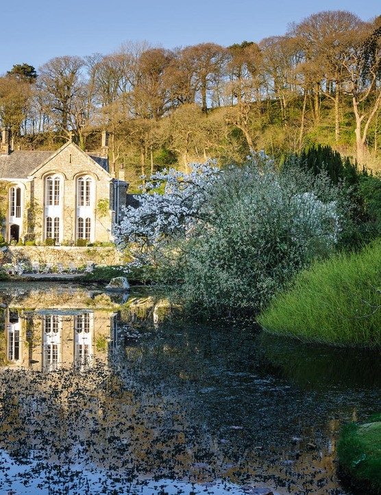 "Cradled by the valley, the house is wedded to the garden by the lake. When Arabella arrived at Gresgarth the lake was nothing more than ""a little comma shape"", but now it reaches the house terrace and forms a lovely focal point to the garden."
