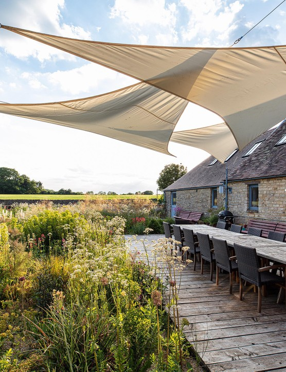 The garden is designed for socialising. The space is sunlit for most of the day and is especially magical in the evening when the setting sun illuminates the flowers of the Stipa gigantea. Seedheads of Allium hollandicum 'Purple Sensation' and Allium siculum add further interest.