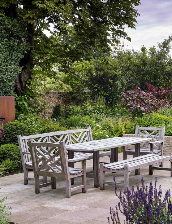 A relatively small space has been made to feel much bigger with fulsome planting of varying heights. The mix of textures from paving, to brick to the Corten steel water feature add a dynamism to the garden too.