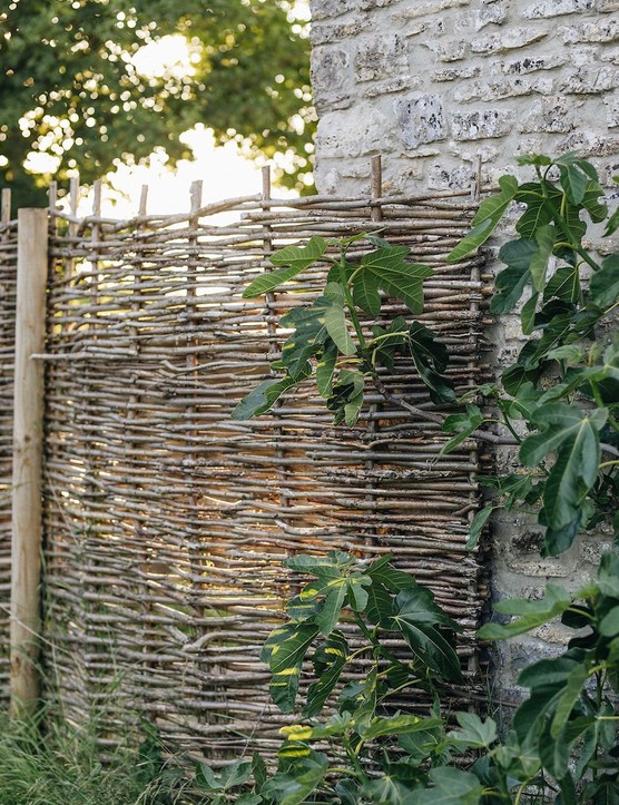 Hazel hurdles are a sympathetic way of enclosing and protecting the Vegetable Garden in the gap between the Farrowing House and the long, low Calf House.