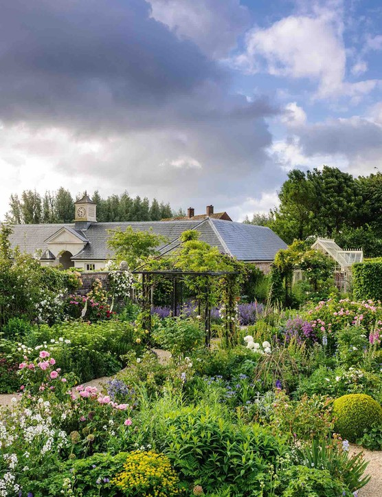 Cutting flowers and organic produce for the kitchen sit happily together in an attractive walled garden that extends in an easterly aspect from the rose garden. At the far end, a glasshouse provides warmth for bringing on early crops.
