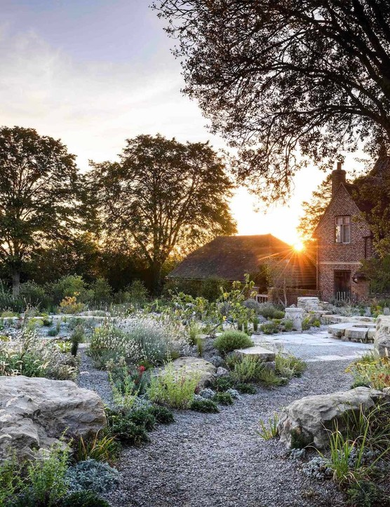 Sissinghurst's Delos garden has been transformed into a Mediterranean-style space in line with the original vision. Grecian altars and a Mediterranean kermes oak are placed along the main walkway