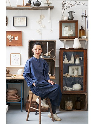 """Kaori in her Camberwell studio. """"I like to be surrounded by old objects,"""" she says, """"somehow they inspire me."""" She works on a high mezzanine floor and must carry all her work down rickety, bannister-less stairs to the kiln."""