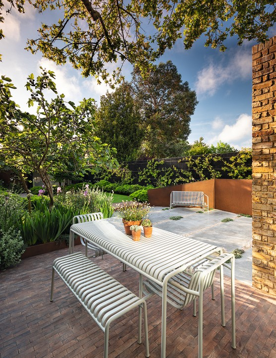This small but elegant seaside garden faces southeast and in the early morning, as the sun rises above its boundary, the space is dramatically brought to life by slanting beams of light, which highlight the contrasting textures of velvety grass lawn and polished concrete terrace.