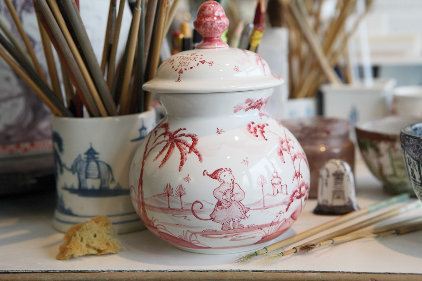 A hand-painted, tin-glazed earthenware piece by Deborah Sears of Isis Ceramics