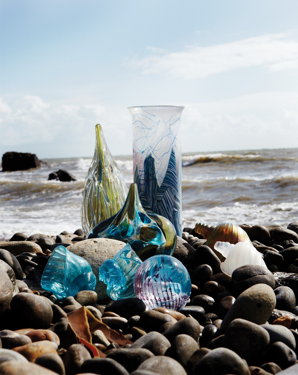 Isle of Wight Studio Glass pieces in their natural setting on the beach