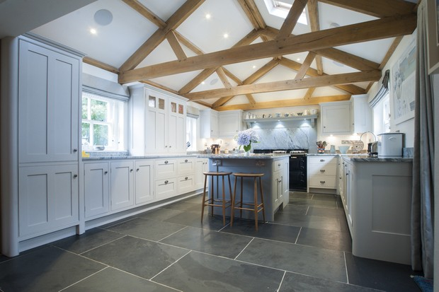 A kitchen featuring exposed beams above