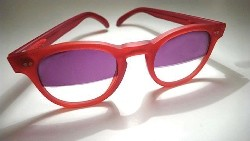 A pair of red vintage sunglasses