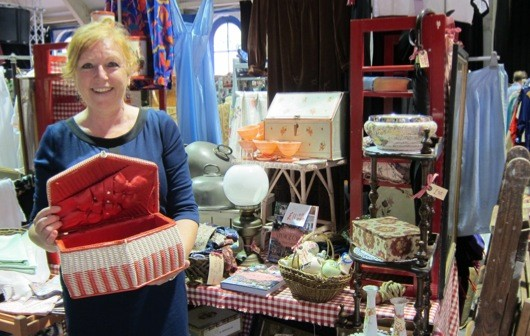 Lorraine Race holding a red sewing box she'd recently purchased