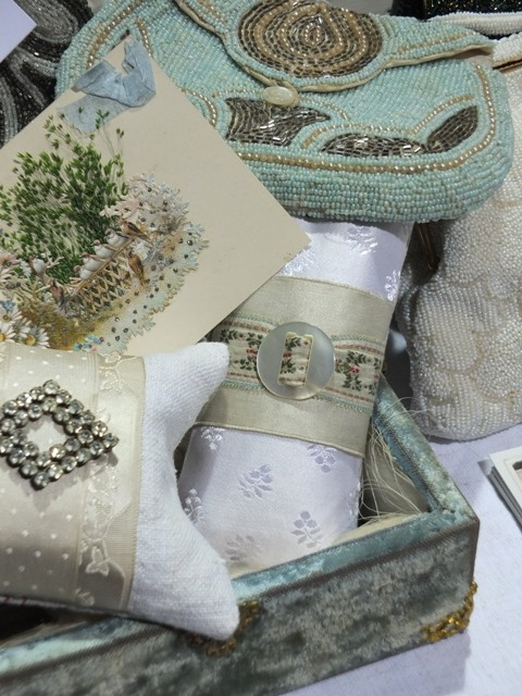 An array of vintage beaded bags on a stall at a flea market