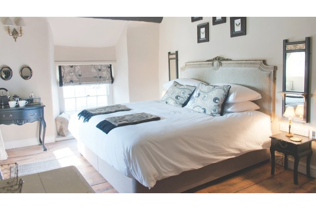 A double bed room at The White Hart in Somerset
