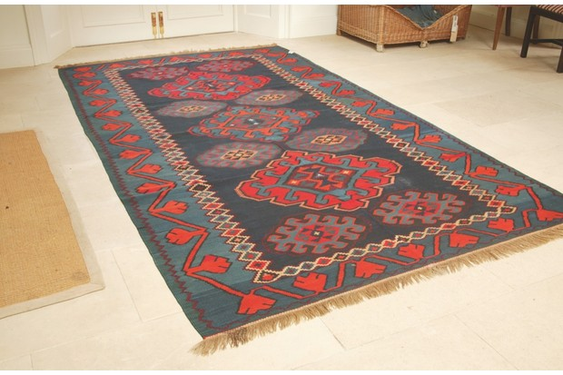 An image of an antique rug