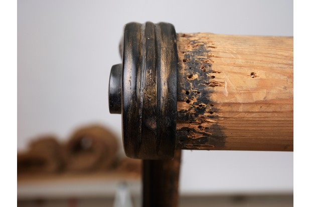 A corner of an antique dining chair, eaten by woodworm
