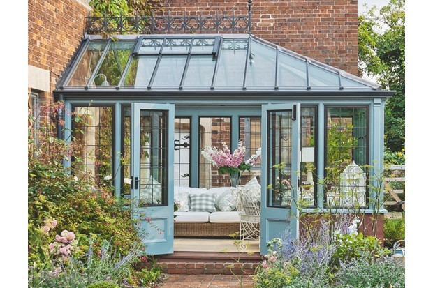 This Elizabethan-inspired 'Hardwick' conservatory (£24,500) by National Trust Conservatory Collection complements the original building