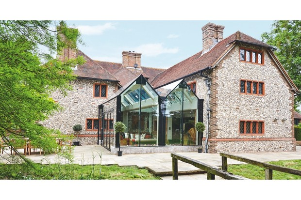 Look to designs that complement rather than compete with your home, even on a modern addition, where minimalist structural glazing by Trombe (from £30,000) echoes existing roof lines