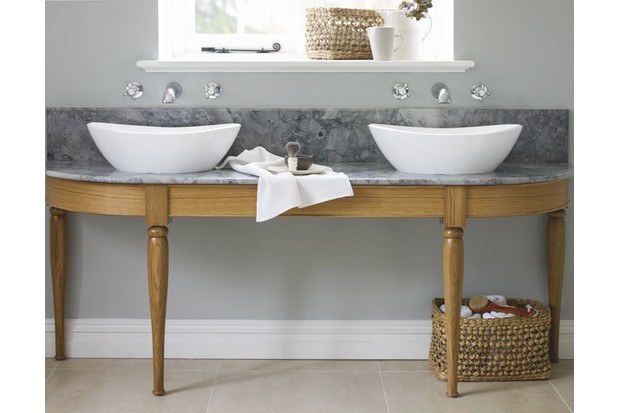 This bespoke twin washstand (from £1,999) by Podesta features an oak stand with hand-turned legs and a Bianco Eclipsia marble surface