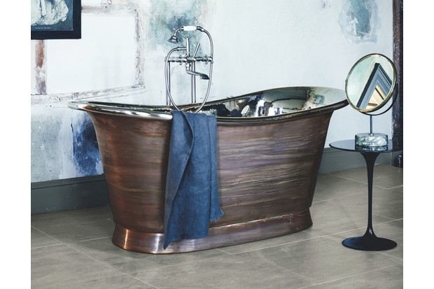 Fired Earth's copper 'Babylon' bath (from £5,750) features a polished nickel interior, is available in three sizes, and is shown here with 'Mademoiselle' bath and shower mixer in brushed nickel (£1,175)