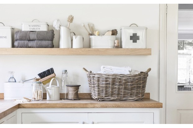 Bembridge laundry basket, £80; set of two rectangular baskets, £100; utility bucket, £22, First Aid box, £28, glass storage jars from £8.50, all Garden Trading