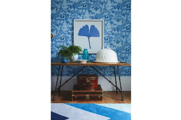 Luggage: Round hat box, as before. 1970s Louis Vuitton shoe case, £5,500, Oliver Oulton at The Furniture Cave. Other items: Chinese toile wallpaper, as before. Ginkgo leaf print, £540, Trowbridge Gallery. Reclaimed oak console table, £3,200, Paolo Moschino for Nicholas Haslam. On console, from left: Serex blue glass vase (used as planter), £25, Heal's. 19th-century French confit jug used as planter, £240, Maison Artefact. 19th-century English porcelain dish, £85, Maison Artefact. Large aqua thistle vase, £165, Paolo Moschino for Nicholas Haslam. Armadale cloche platter, £298, Anthropologie