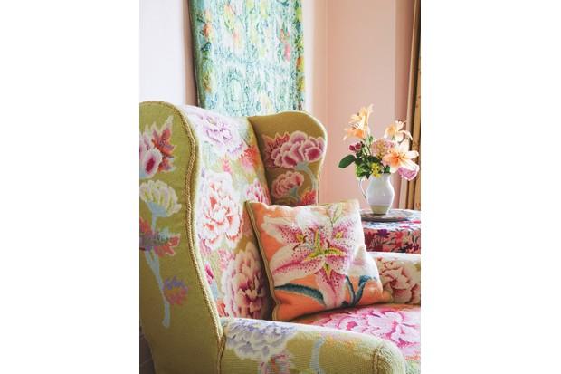 A lime green needlepoint armchair