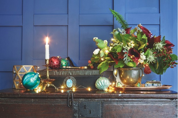 Chest, find similar at Puritan Values. Candle holder, as before. Marble bauble, £6, John Lewis. Benham & Froud chamberstick, c1900, £695 for two; Arts and Crafts box, £385, both The Design Gallery. Trellis and scalloped baubles, £4.50 each, both John Lewis. Magnifying glass, £19.95, Rockett St George. Tray (part of set), c1905, £1,250; silver-plated box, £695, both The Design Gallery. Pewter bowl (part of a set by William Hutton), £3,500 (for the set), Puritan Values. Art deco bauble, as before. Wire lights, £12, Nordic House