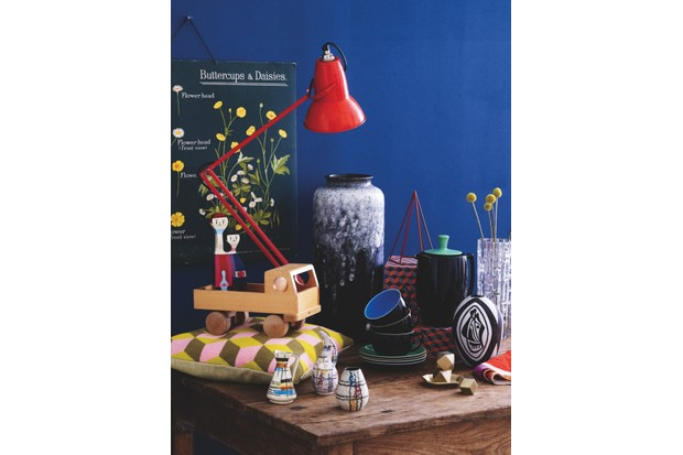 Red 'Anglepoise' lamp, £295 (plus VAT), Retrouvius. Wooden toy truck, £45, Matt Mitchell London. Vitra 'Wooden Doll No 11', £85, The Design Museum Shop. 'Falling Cubes' yellow cushion by Fine Cell Work, £95, Pentreath & Hall. Ceramic miniature vases, £23 each, The Old Cinema. 'Large Monochrome Fat Lava' vase by Bay Keramik, £55, Homeplace. Breakfast cups and saucers, £29 each; coffee pot in 'Jet Black', £99, all Branksome China. Red geometric shape, £30, Mar-den. Boxes in 'Falling Cubes' wrapping paper, £3 per sheet, Pentreath & Hall. Brass paperweights, £38 each; brass stationery tray, £35, all Native & Co. Danish black-and-white vase, £25, The Old Cinema. 'Boulder' napkin, £20, Dinosaur Designs. Geometric glass vase, £120, The Old Cinema. Farmhouse table, £750, Gear Antiques. On wall: rare vintage botanical chart, £85, Homeplace