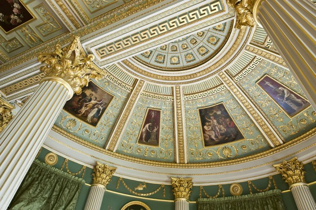 An image of the ornate gold and green ceiling at Spencer House in London