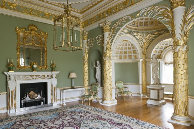 The palm room in Spencer House is painted a rich green with ornate gold pillars and cornice work to represent palm leaves.