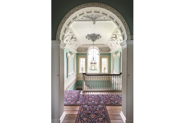 The upstairs landing featuring Palladian arched windows