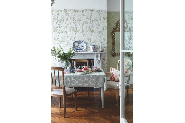 A green and pink chinoiserie style wallpaper in the dining room