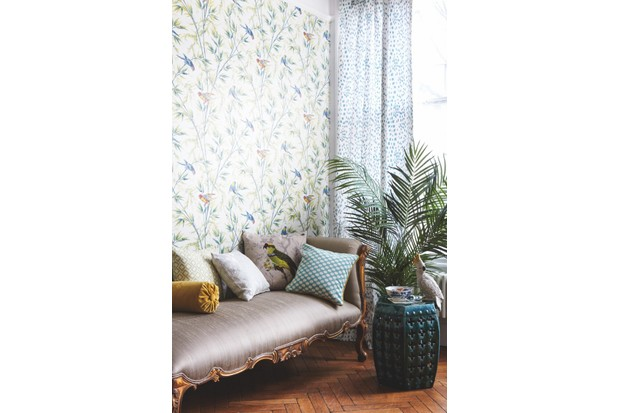 Walls in 'Great Ormond St' wallpaper in 'Tropical', £86 per roll, Little Greene. Curtain in 'Les Touches' in 'Aqua', £85 per m, Brunschwig & Fils. 'Versailles' chaise longue, £1,060, The French Bedroom Company. On chaise (from left): yellow bolster in 'Taormina', £59 per m, Sanderson; cushion in 'Mazely' in 'Leaf Green', £65 per m, Colefax & Fowler; cushion in 'Pure Poppy Embroidery' in 'Wild Mint', £95 per m, Morris & Co; 'Woodpecker' cushion, £85, Timorous Beasties; cushion in 'Madera' in 'Turquoise', £118 per m, Manuel Canovas. Chinese stool, £850 per pair, Guinevere Antiques Ltd. On stool: antique bowl, £395, Graham Smith Antiques Ltd; cockatoo, £36, Rockett St George. Faux palm tree, £128, Mia Fleur.