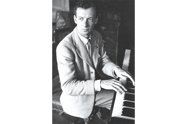 English composer and pianist Benjamin Britten (1913 - 1976) rehearsing his opera 'The Rape Of Lucretia' in the organ room at the Glyndebourne opera festival, 1946. Original Publication: Picture Post - 4139 - A New Opera For Glyndebourne - pub. 13th July 1946 (Photo by Gerti Deutsch/Hulton Archive/Getty Images)