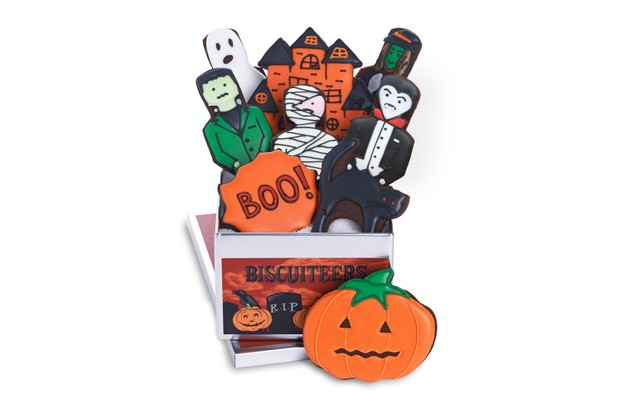 A Biscuiteers Haunted House biscuit tin featuring edible biscuit pumpkins, mummies, vampires and Frankenstein's monster