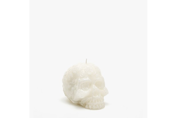 white Skull candle with embossed floral design