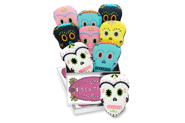 Biscuiteers day of the dad colourful skull shaped biscuits displayed around a tin