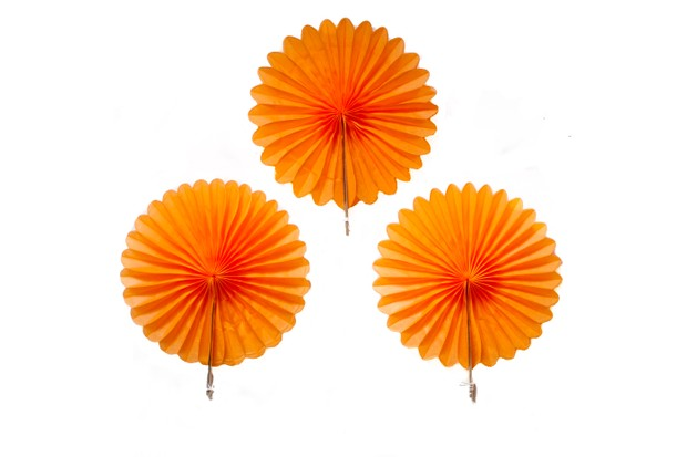 3 orange paper fans that represent marigolds used to celebrate the day of the dead