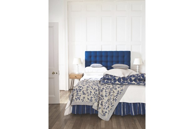 Headboard in 'Campbell Union Navy', £42.50 per m; bedcovers in 'Acton Navy', £39.50 per m, and 'Kew Nordic Navy', £39.50 per m, all Ian Mankin