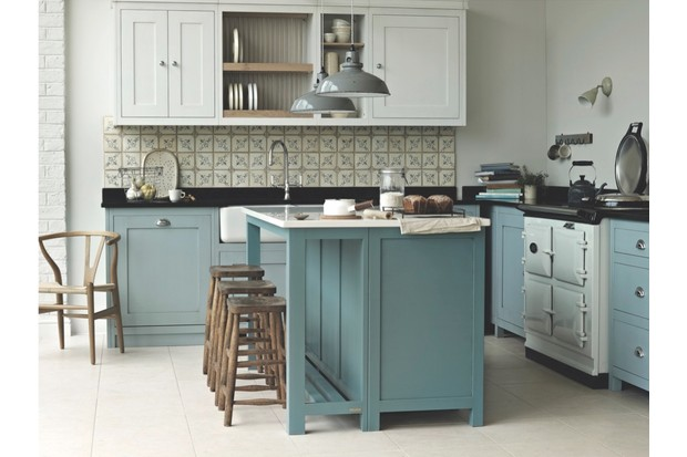 'Vermont' kitchen by Fired Earth. Cabinets painted in 'Dover Cliffs' and 'Smoke Blue'; island unit is in 'Andaman Sea' with a Caesarstone worktop. Prices start at around £10,000