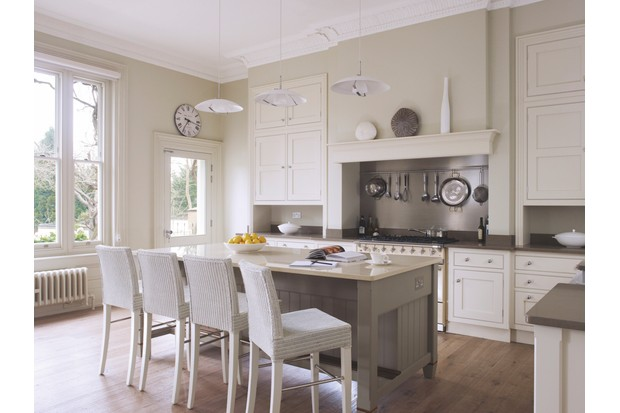 Kitchen from The English collection at Martin Moore with main furniture painted in 'Stone II' and the island in 'Stone III' from Paint & Paper Library. Worktops are in Caesarstone 'Ginger' and Compac 'Botticino'. Martin Moore kitchens start from £35,000