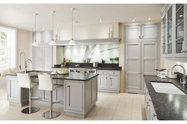 This 'New Classic' kitchen is lit in a combination of ways: recessed downlights in the ceiling provide ambience, more downlights in the alcove highlight the marble splashback, and a trio of pendant lights illuminate the island. The lighting scheme is part of an overall kitchen design by Martin Moore
