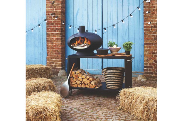 Hay bale seating surrounding an outdoor cooking station