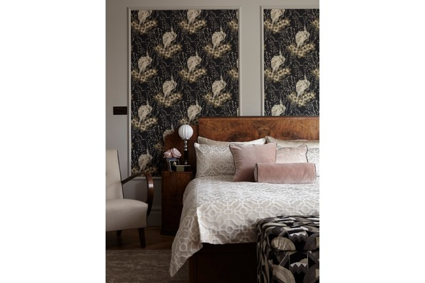 Large panels of floral wallpaper displayed in frames in an Art Deco bedroom