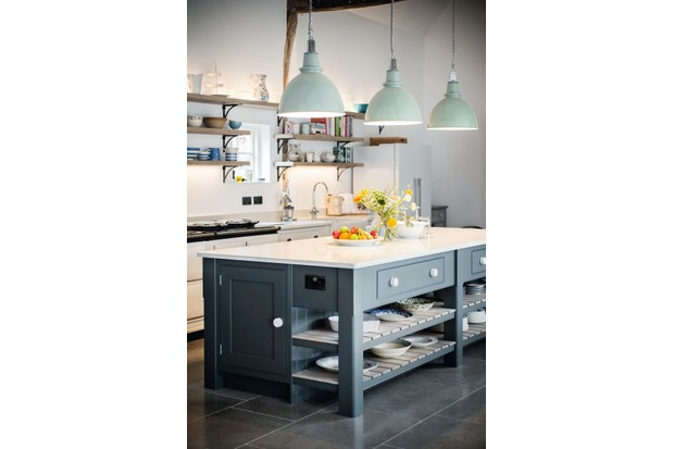 A dark grey kitchen island with marble worktops