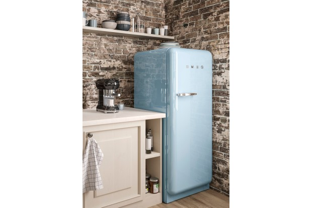 An industrial-style kitchen with a blue Smeg fridge