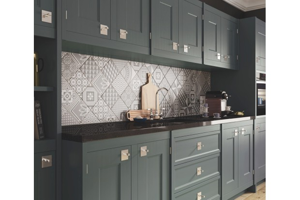A dark grey contemporary kitchen with geometric wall tiles