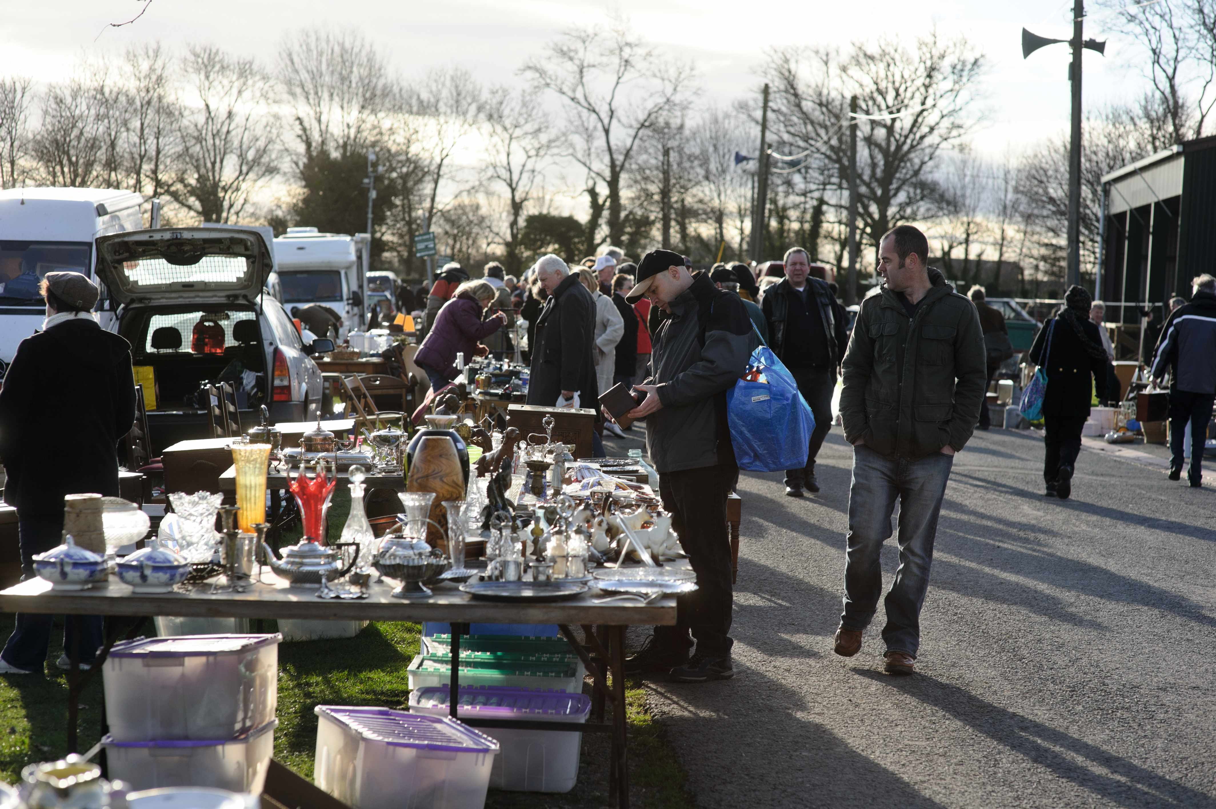 Antiques-hunters browse a stall of small curios at the Malvern Flea & Collectors fair