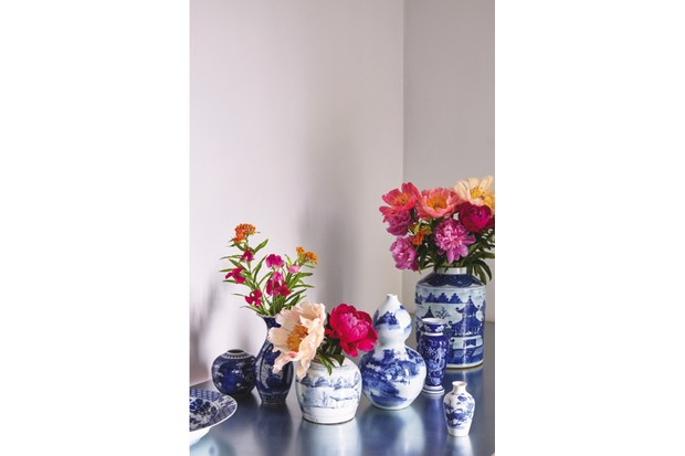 Oriental Blue and White vases filled with fresh flowers on a silver side table