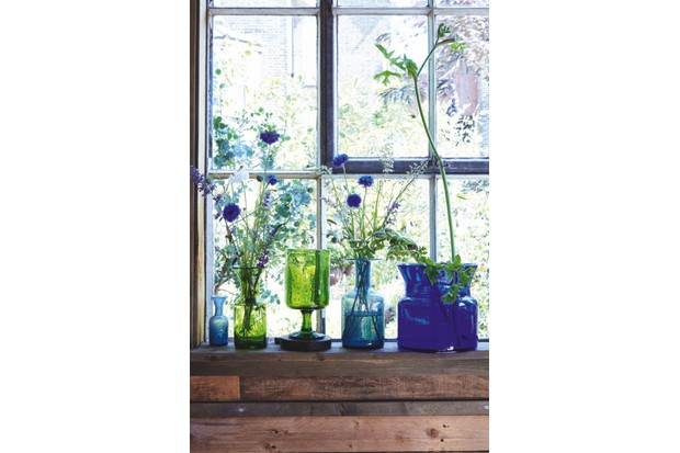 Mid-century Scandinavian Glass Vases filled with tall blue flowers and eucalyptus in front of an open sash window