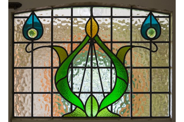Detail of a stained glass panel on the the North (entrance) Front of Shaw's Corner, Hertfordshire.