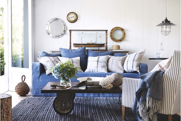 A living room with a loosely covered sofa